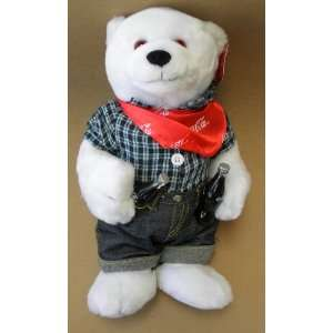 rolled up jeans and bandana scarf. The polar bear is holding two coke