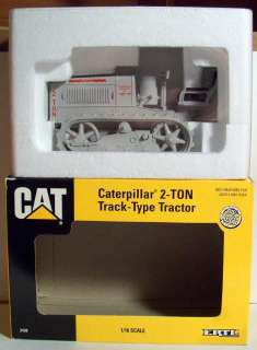 is a 1993 Ertl 1/16 scale Cat Caterpillar 2 Ton Track Type Tractor